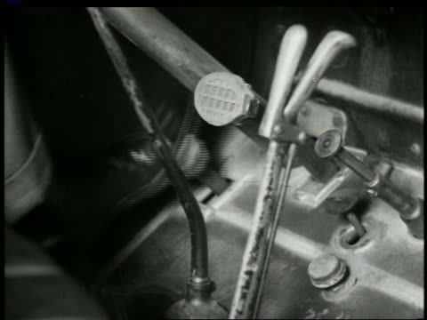 b/w close up man's feet stepping on brake + clutch pedals in 1924 buick - pedal stock videos & royalty-free footage