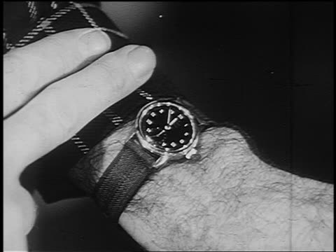 b/w 1951 close up man's fingers holding sleeve back from watch on man's wrist - yorkville illinois stock videos & royalty-free footage