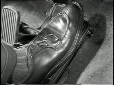 B/W 1949 close up man's foot presses gas pedal in car