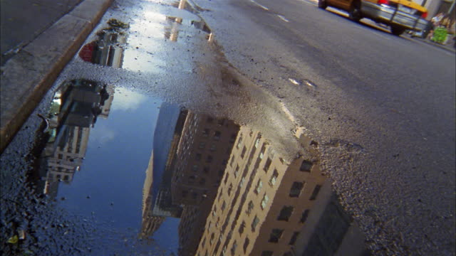 close up man's foot stepping in puddle on city street - puddle stock videos & royalty-free footage