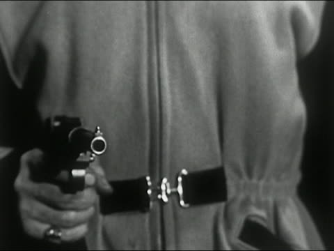 1950 close up man's hand holding gun / pan up to sinister face with hat, glasses and stubble talking  / audio - stubble stock videos and b-roll footage