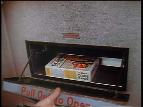 stockvideo's en b-roll-footage met 1957 close up man's hand opening door of vending machine + taking out box of corn flakes / food-o-mat - 1957