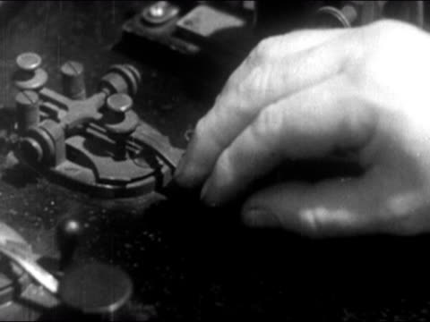 1946 close up man's hand operating early telegraph machine - telegraph machine stock videos & royalty-free footage