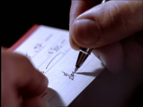 vídeos y material grabado en eventos de stock de close up man's hand signing check with pen - escribir