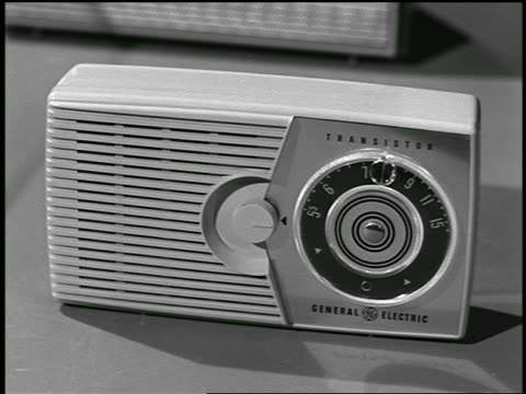 b/w 1957 close up man's hand touching small general electric transistor radio / industrial - general electric stock videos and b-roll footage