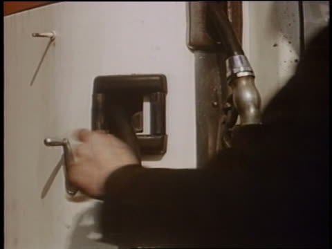 1958 close up man's hand turning knob on gas pump - filling station attendant stock videos and b-roll footage