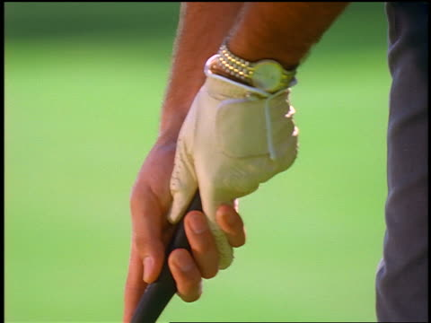 close up man's hands gripping golf club / glove on one hand - golf club stock videos & royalty-free footage