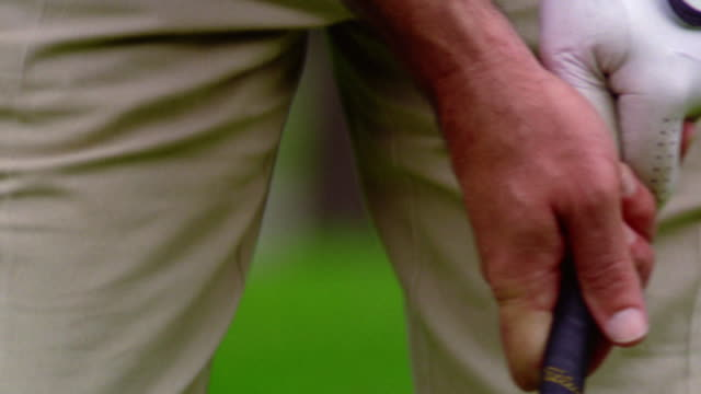 close up man's hands in golf glove gripping golf club - golf glove stock videos and b-roll footage