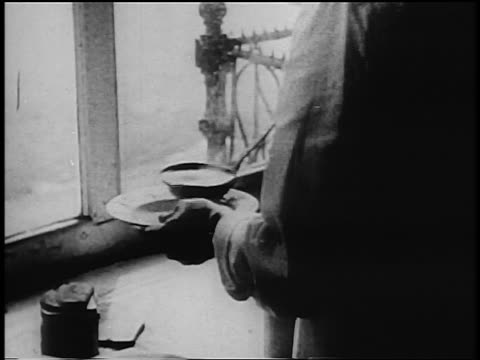 b/w 1933 close up man's hands ladling soup into bowl in soup kitchen during great depression - soup kitchen stock videos & royalty-free footage
