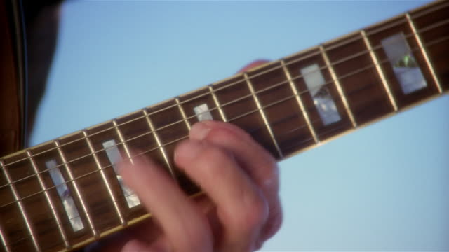 close up man's hands playing electric guitar - electric guitar stock videos & royalty-free footage
