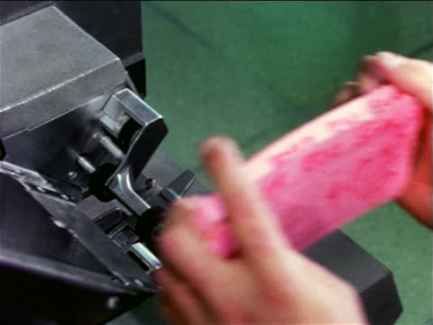 1965 close up man's hands putting stack of pink cards into computer / documentary - punch card reader stock videos & royalty-free footage