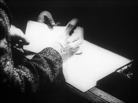 b/w 1923 close up man's hands stamping passport / mein kampf documentary - 1923 stock-videos und b-roll-filmmaterial