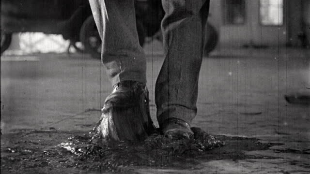 b/w 1924 close up man's shoes stuck in glue / the mechanic - glue stock videos and b-roll footage