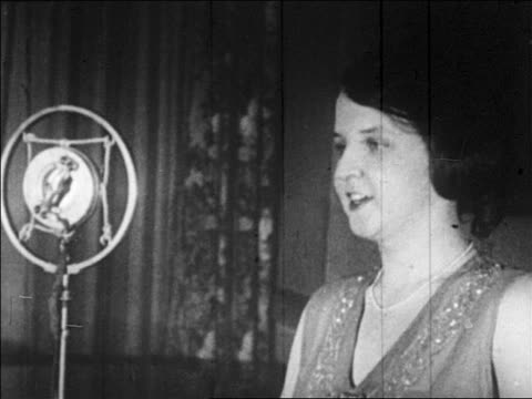 b/w 1926 close up marion talley singing into microphone in radio studio - 1926 stock videos & royalty-free footage