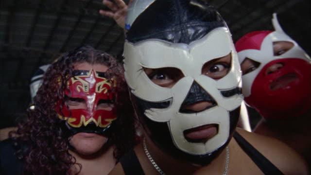 Close up masked luchadores looking menacingly at CAM / Queretaro, Mexico