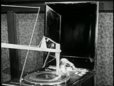 b/w 1923 close up match attached to phonograph player attached to string moving / short - 1923 stock-videos und b-roll-filmmaterial