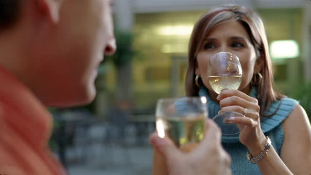 close up mature couple having glass of wine/ san antonio, texas - polo neck stock videos & royalty-free footage