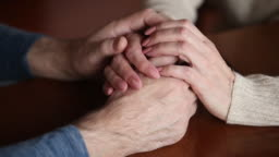 Close up mature couple woman and man holding hands