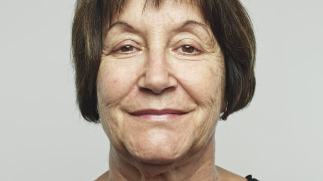 Close up mature happy woman video portrait