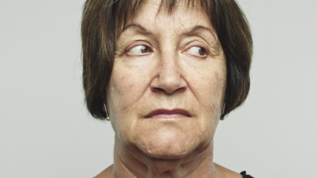 Close up mature woman looking around