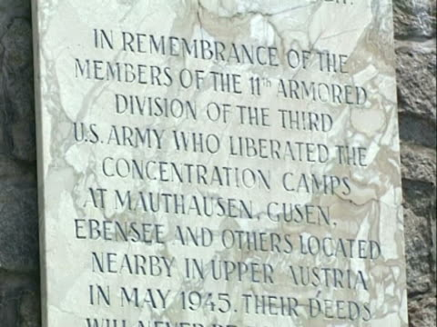 / close up mauthausen concentration camp marble commemorative plaque - memorial plaque stock videos and b-roll footage