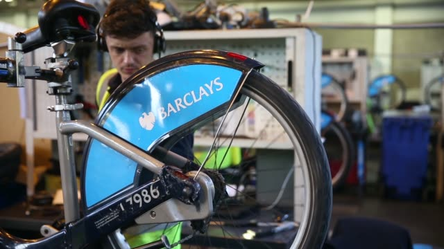 close up, mechanics repair damaged barclays cycle hire bikes in the mechanical workshop of the cycle hire's penton street depot on september 5, 2013... - new hire stock videos & royalty-free footage