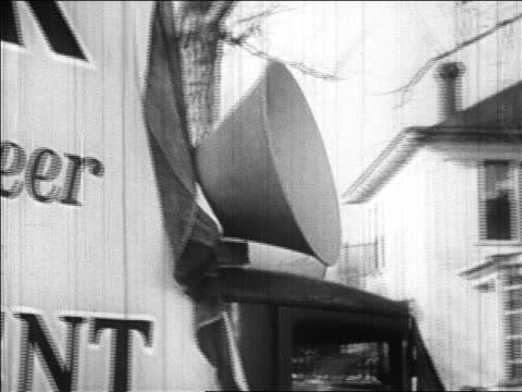 b/w 1928 close up megaphone on van with large advertisement for herbert hoover in campaign / newsreel - 1928 stock videos & royalty-free footage