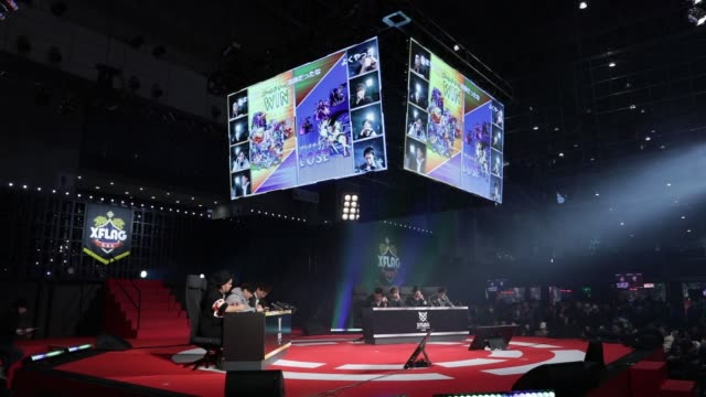 Close up members of a game team play Mixi Inc's Monster Strike games in a final match during the Tokaigi Game Party Japan esports competition at the...