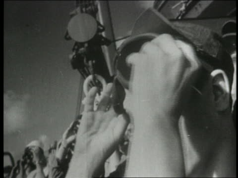 b/w 1954 close up men putting on goggles to view atom bomb explosion - 1954 stock videos & royalty-free footage