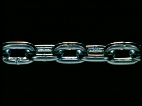 close up metal chain breaking apart - chain stock videos & royalty-free footage