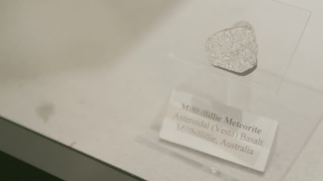 Close up, meteorite in glass display case