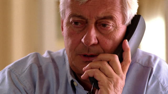 close up middle age/mature man talking on telephone