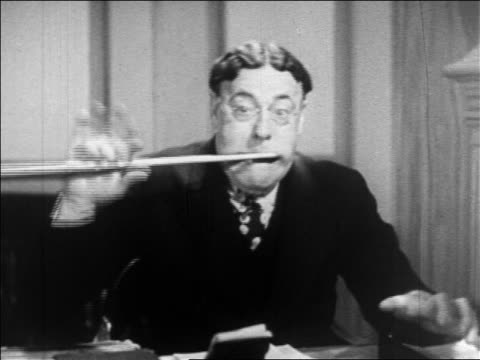b/w 1936 close up middle-aged man with eyeglasses removing violin bow from his mouth / feature - only mature men stock videos & royalty-free footage
