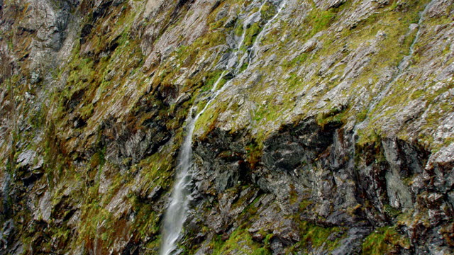 close up milford sound waterfall aerial - igneous stock videos & royalty-free footage