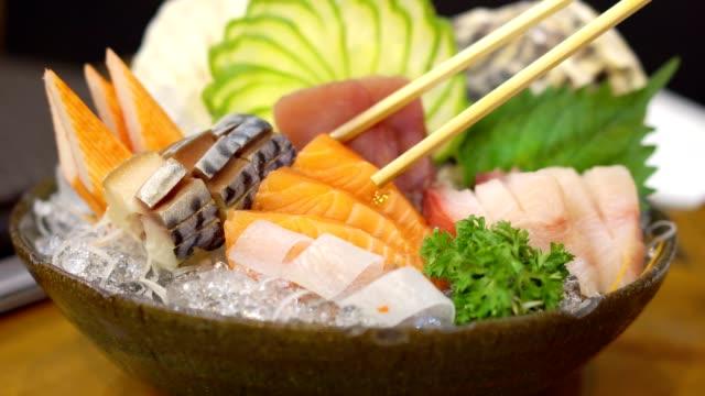 vídeos de stock e filmes b-roll de close up, mixed sashimi set. japanese food. - sashimi
