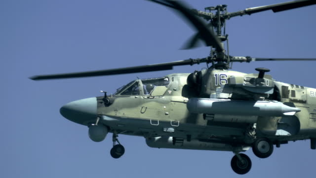 close up - modern military helicopter hovers in the air - military helicopter stock videos & royalty-free footage