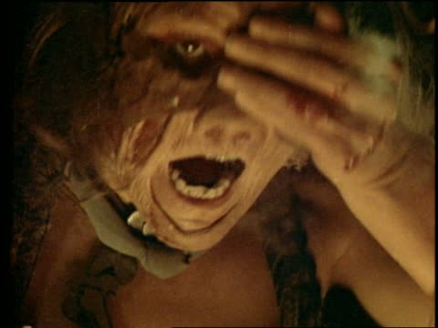 close up monster clutching eye with bloody hand + screaming - 1982 stock videos and b-roll footage