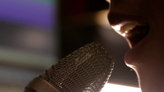 close up mouth of man singing with microphone - microphone stock videos and b-roll footage