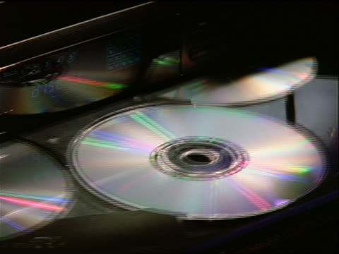 vidéos et rushes de close up multi disc cd player rotating with cd's - 1990 1999