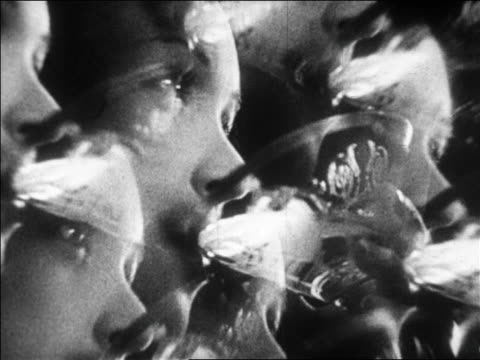 B/W 1928 close up MULTIPLE EXPOSURE PROFILE woman drinking champagne / newsreel