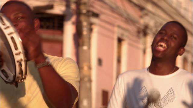 close up musicians singing salsa music and performing  / rio de janeiro / brazil - サルサダンス点の映像素材/bロール
