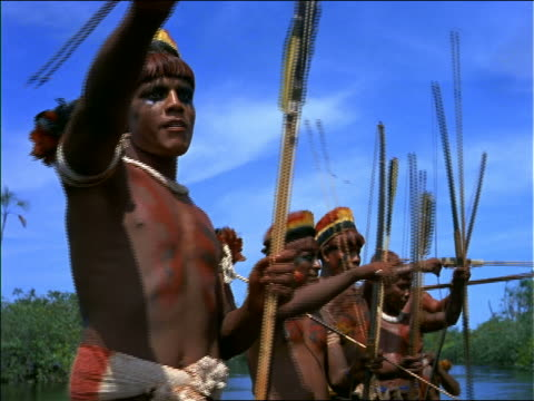 close up native men gesturing offscreen + talking / amazonas, brazil - bow and arrow stock videos and b-roll footage