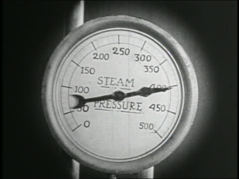 b/w 1935 close up needle climbing on steam pressure gauge / feature - messinstrument stock-videos und b-roll-filmmaterial