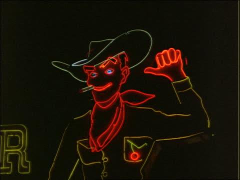 close up neon cowboy on Las Vegas strip at night