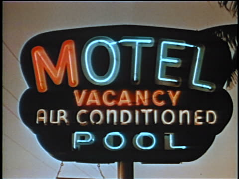 "1958 close up neon ""motel, vacancy, air conditioned, pool"" sign / may be florida / newsreel - motel stock videos and b-roll footage"