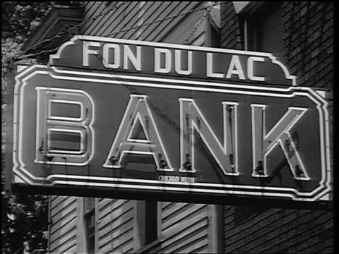 b/w 1934 close up neon sign for fon du lac bank / east peoria, il / newsreel - 1934 stock videos & royalty-free footage