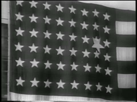 close up new big star on 48-star american flag / alaska statehood - anno 1958 video stock e b–roll