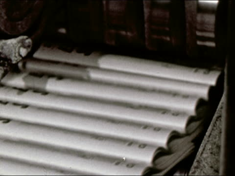 1964 close up new york newsday newspapers coming out of the printing press / audio - ニューヨークニュースデイ点の映像素材/bロール