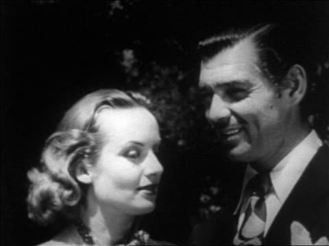 vídeos y material grabado en eventos de stock de close up newlyweds clark gable + carole lombard looking into each others eyes outdoors / newsreel - pareja de mediana edad