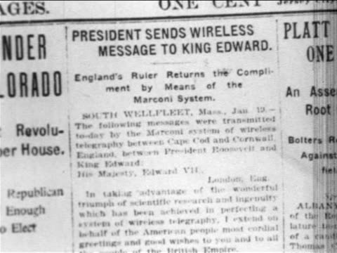 b/w 1902 close up newspaper article on invention of wireless telegraph / newsreel - telegraph machine stock videos & royalty-free footage